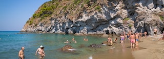 San Francesco Beach showing general coastal views, rocky coastline and swimming