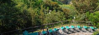 Nitrodi Hot Springs featuring rugged coastline and general coastal views