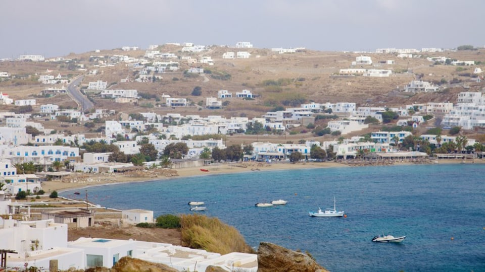 Ornos Bay which includes general coastal views, a coastal town and boating