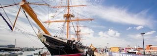 HMS Warrior showing heritage elements and a bay or harbor