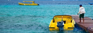 Gili Islands featuring boating and surf as well as an individual male