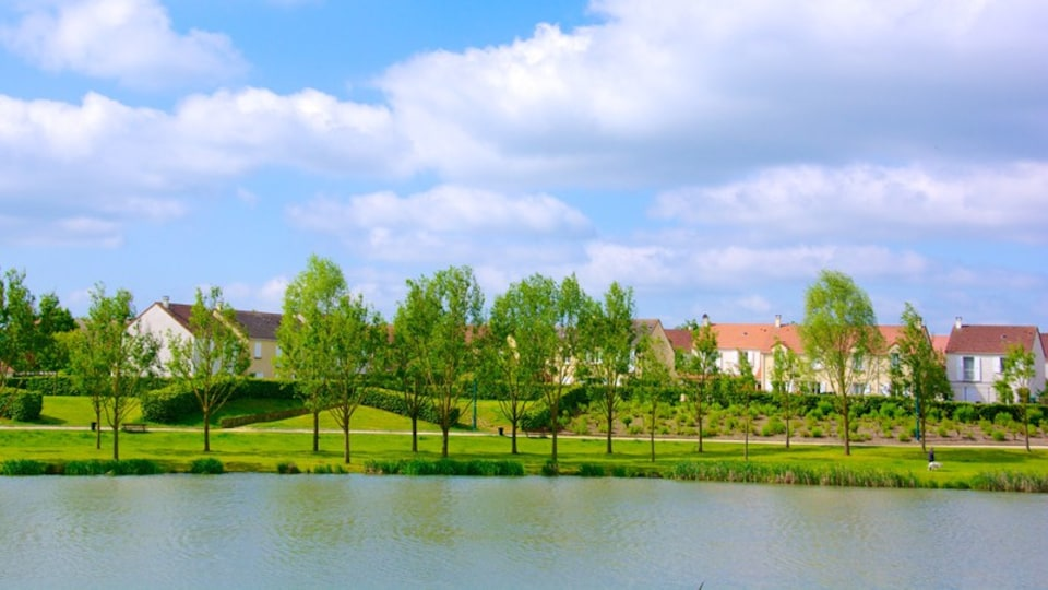 Marne-la-Vallee which includes a river or creek and a park