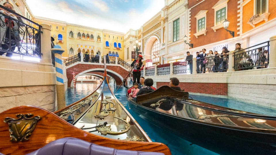Venetian Macao Casino which includes interior views, boating and a river or creek