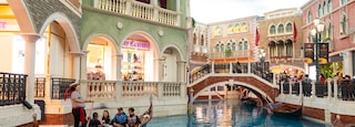 Venetian Macao Casino showing boating, a river or creek and interior views