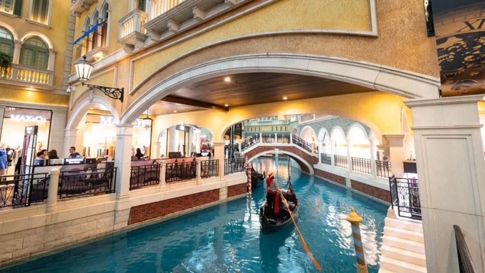 Venetian Macao Casino which includes a river or creek, boating and interior views