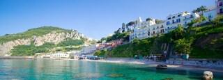 Capri showing a coastal town, rugged coastline and swimming