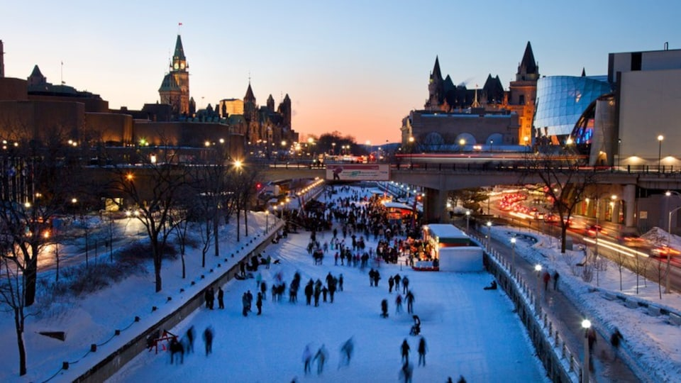 Rideau Canal featuring snow, a sunset and a city