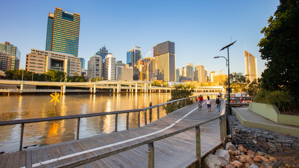South Bank Parklands featuring a sunset, a river or creek and a city
