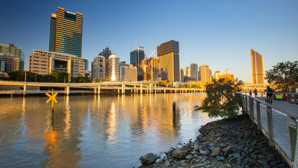 South Bank Parklands showing a sunset, a river or creek and a city