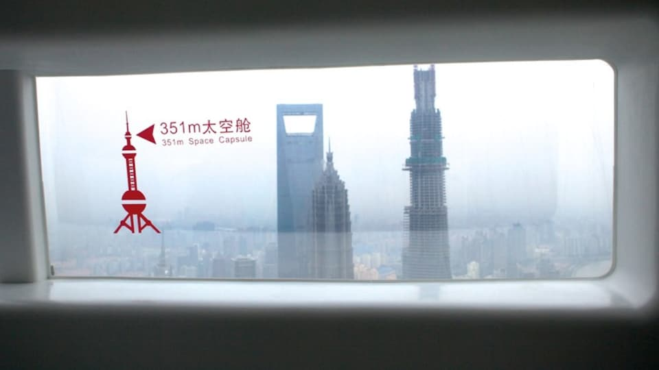 Oriental Pearl Tower featuring a city, signage and a skyscraper
