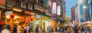 Tamsui Old Street which includes street scenes, a city and night scenes