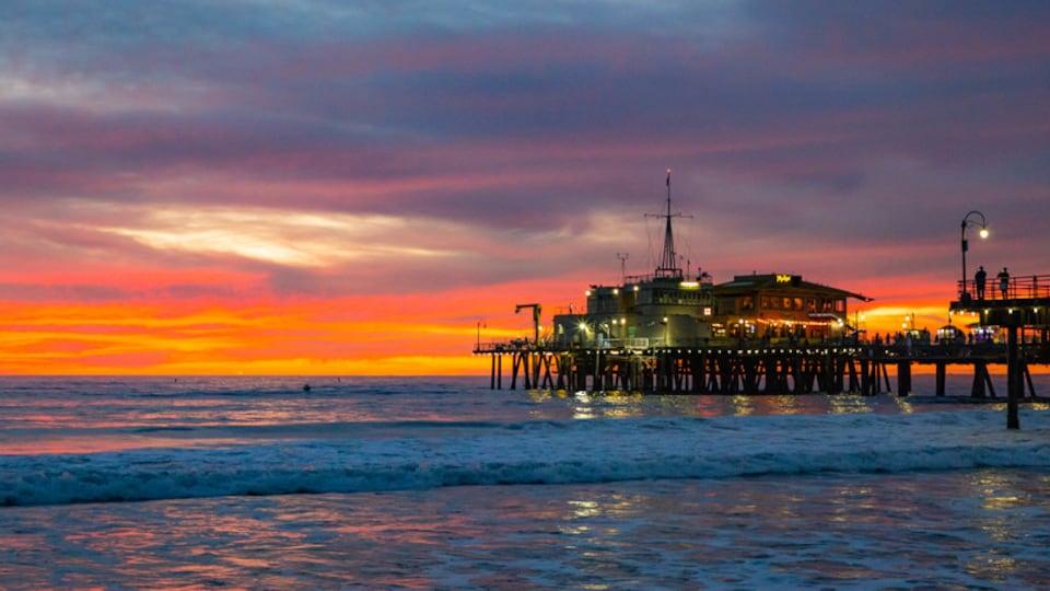 Santa Monica Pier showing a sunset and general coastal views