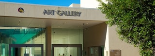 Queensland Art Gallery showing art, signage and a city