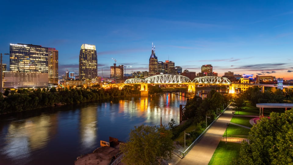Downtown Nashville featuring a city, a bridge and a river or creek
