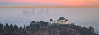 Griffith Observatory featuring a city, a sunset and an observatory