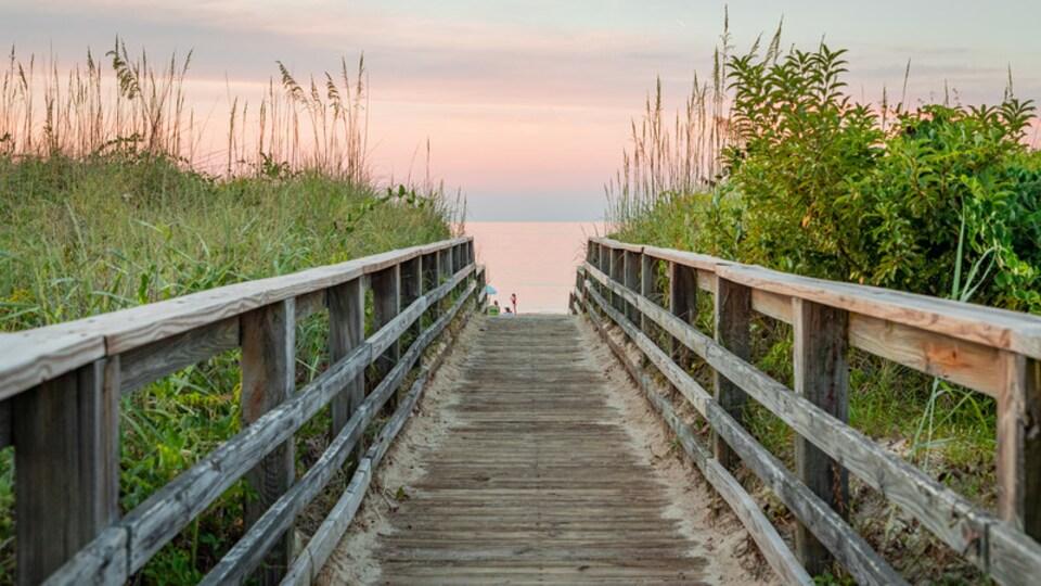 Ocean View featuring a bridge, general coastal views and a sunset