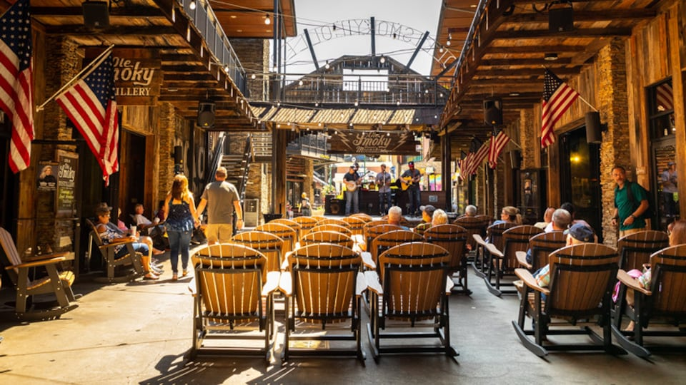 Ole Smoky Moonshine Distillery showing music and performance art as well as a small group of people