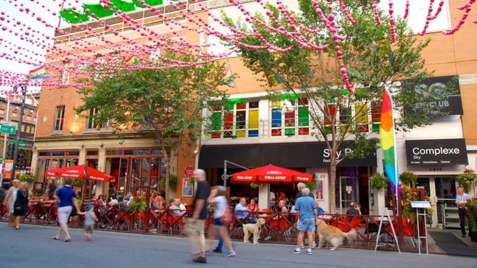 Gay Village which includes outdoor eating, signage and street scenes