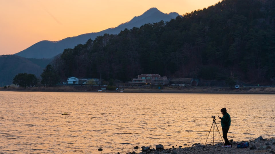 Lake Kawaguchi which includes a lake or waterhole and a sunset as well as an individual male