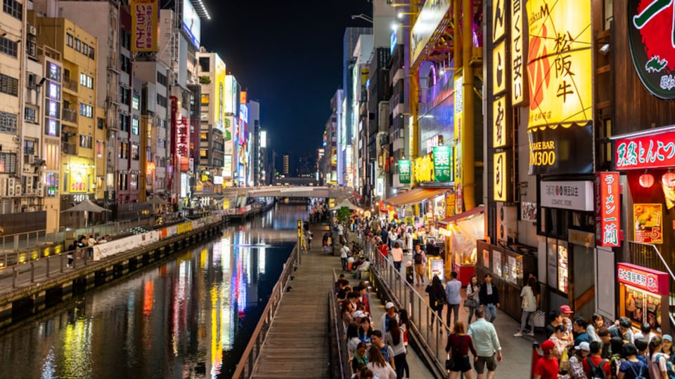 Shinsaibashi showing street scenes, a river or creek and a city