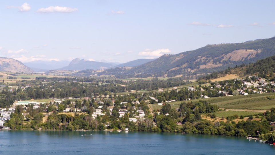 Vernon which includes a lake or waterhole, landscape views and tranquil scenes