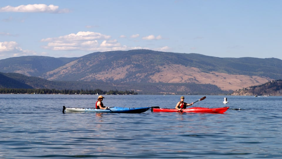 Vernon featuring a lake or waterhole and kayaking or canoeing as well as a couple