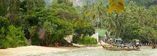 West Railay Beach featuring a sandy beach, boating and tropical scenes
