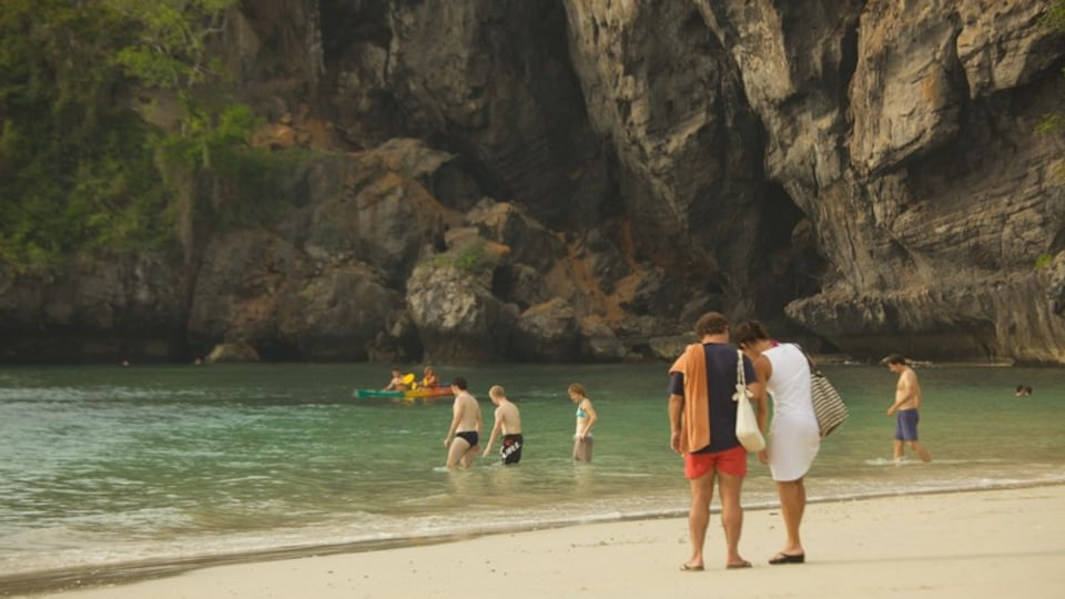 West Railay Beach showing a sandy beach, rugged coastline and swimming