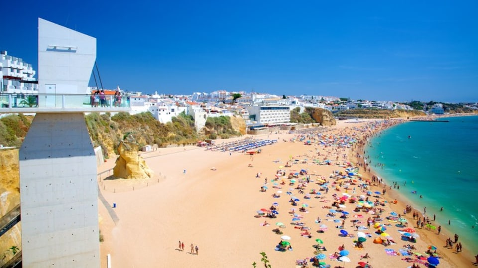 Albufeira featuring swimming, a beach and a coastal town