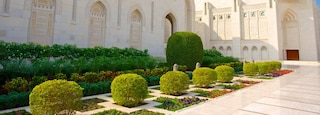 Muscat which includes a mosque, heritage architecture and a garden