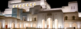 Muscat featuring a square or plaza, heritage architecture and night scenes