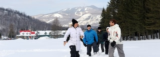 Mont-Tremblant Ski Resort which includes snow and snow shoeing as well as a small group of people