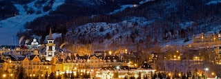 Mont-Tremblant Ski Resort showing mountains, snow and a luxury hotel or resort