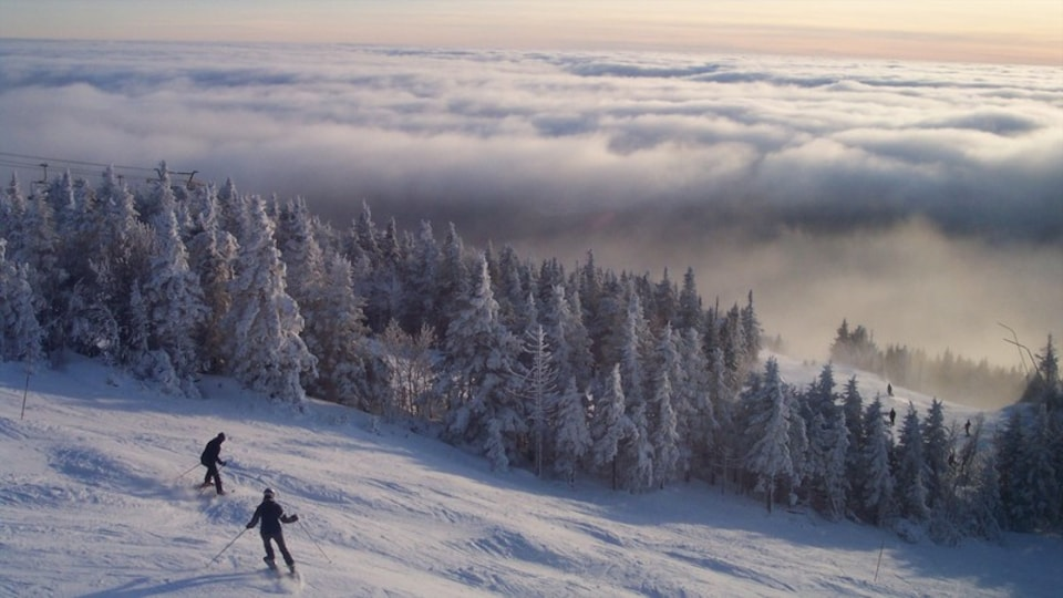 Mont-Tremblant Ski Resort showing snow, snow skiing and mist or fog