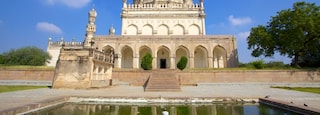 Qutub Shahi Tombs which includes heritage architecture, a pond and a memorial