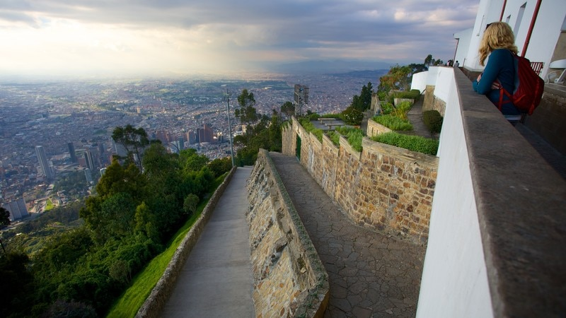 Monserrate which includes a city and views as well as an individual femail
