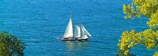 Seneca Lake showing a lake or waterhole and sailing