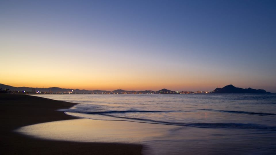 Manzanillo which includes a sunset and general coastal views