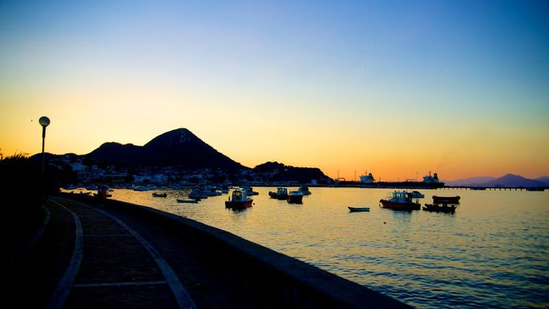 Playa San Pedrito featuring a bay or harbor, a sunset and general coastal views