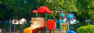 Nicco Park featuring a garden and a playground