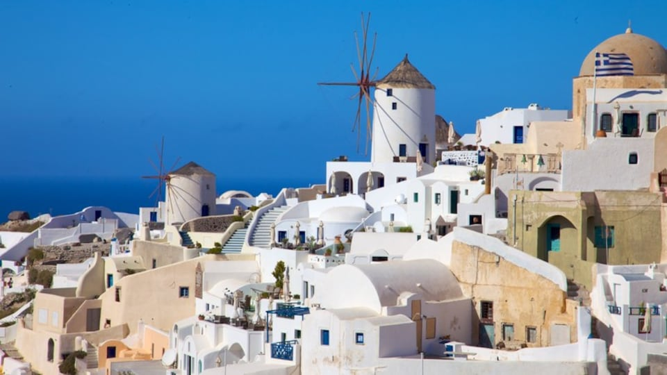 Oia showing a coastal town and a windmill