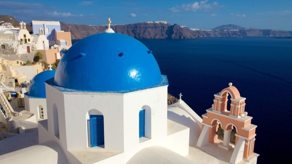 Oia which includes a church or cathedral and a coastal town