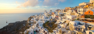 Oia showing a sunset and a coastal town
