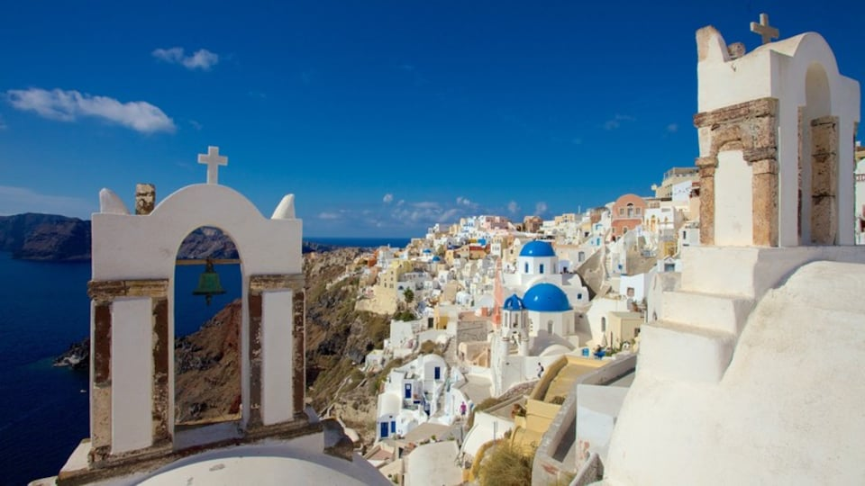 Oia showing a coastal town and a church or cathedral