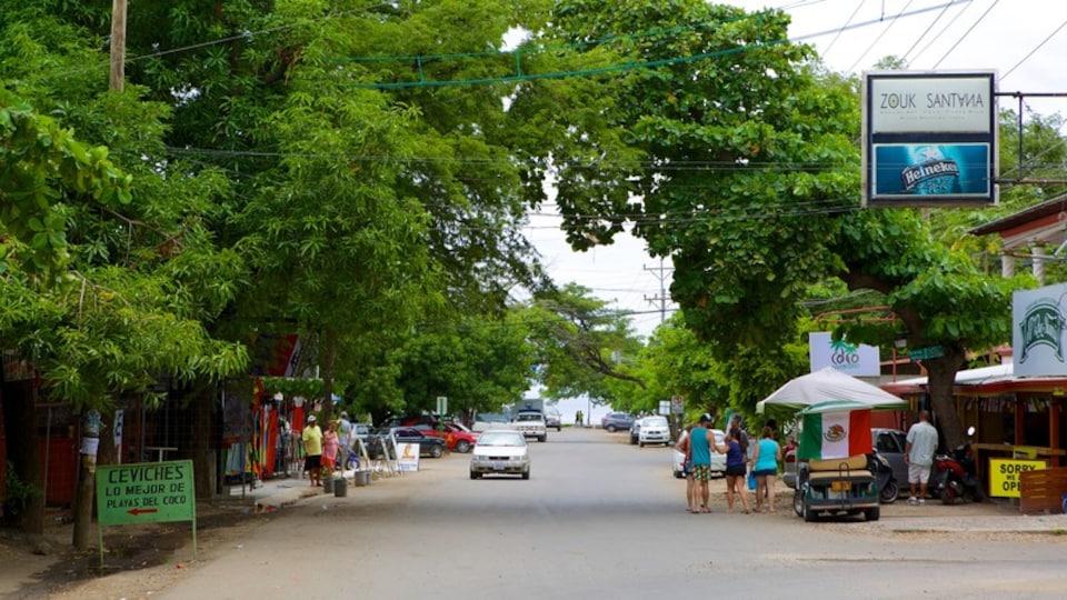 Coco Beach showing street scenes