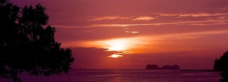 Flamingo Beach featuring a beach, a sunset and landscape views