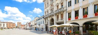 Piazza Ferretto which includes street scenes, cafe scenes and outdoor eating