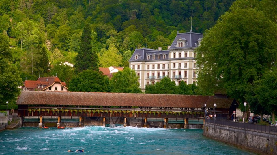 Thun which includes a river or creek and a bridge