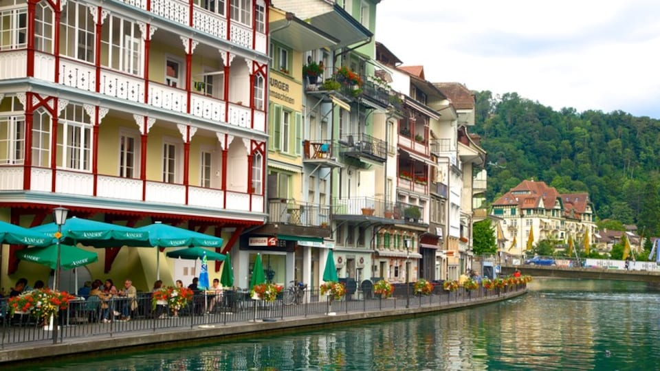 Thun featuring a lake or waterhole, street scenes and outdoor eating