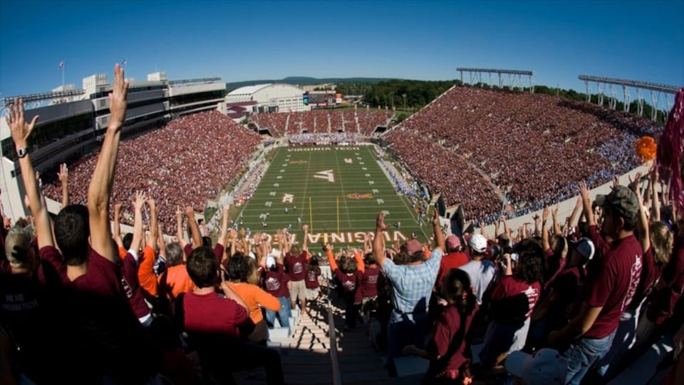 Blacksburg showing a sporting event as well as a large group of people